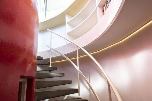 Photo of SWEETS hotel Amsterdam Center bridge house Kortjewantsbrug interior spiral staircase bookcase