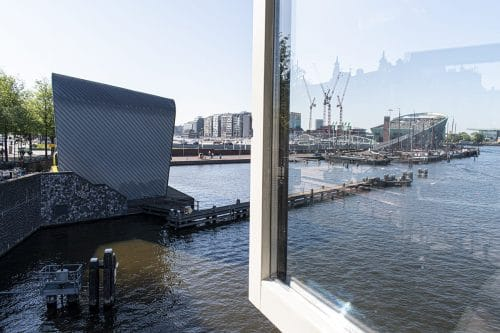 Photo of SWEETS hotel Amsterdam Center bridge house Kortjewantsbrug water view from kitchen arcam architecture centre nemo science museum