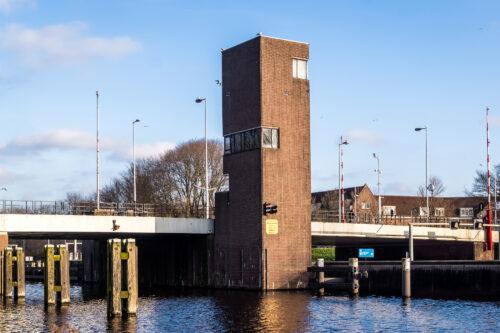 Exterior of SWEETS hotel's bridge house Gerben Wagenaarbrug in Amsterdam Noord; a tower with three floors.