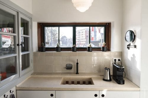 Photo of SWEETS hotel Amsterdam West Overtoomsesluis bridge house interior kitchen mirror