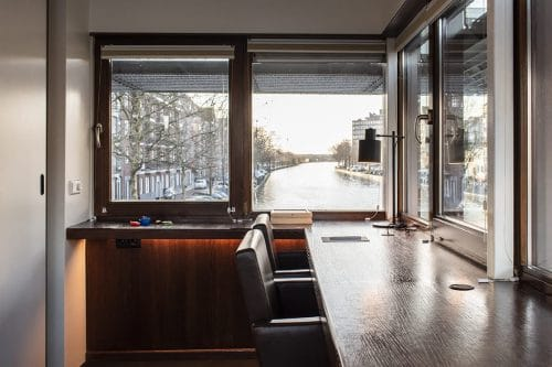Photo of SWEETS hotel Amsterdam West Zeilstraatbrug bridge house interior workspace desk canal view