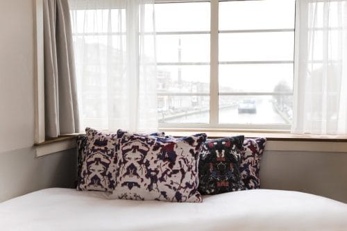 SWEETS hotel Kinkerbrug bridge house on Amsterdam canals - design interior wit Roos Soetekouw pillows, close to Kinkerstraat and Ten Kate markt