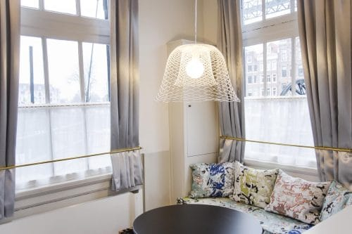 SWEETS hotel Scharrebiersluis bridge house on Amsterdam canals - Gispen design table and handmade pillows Roos Soetekouw