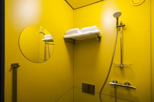 SWEETS hotel Theophile de Bock bridge house on Amsterdam canals - yellow bathroom in tiny house close to Vondelpark