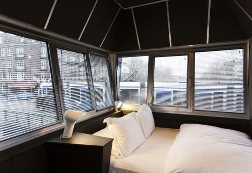 Photo of SWEETS hotel Amsterdam Wiegbrug bridge house on Amsterdam canals - design interior with Sorella lamp