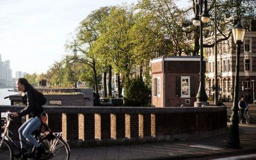 Photo of SWEETS hotel Amsterdam bridge house Nieuwe Amstelbrug surroundings exterior cyclist Amstel river